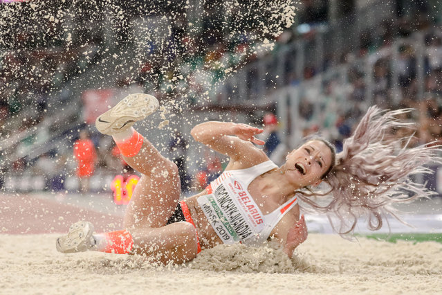 Belarusian long jumper Nastassia Mironchyk-Ivanova lands at the The Match Europe v USA, an international two-day competition between the United States and Europe in Minsk on September 10, 2019. (Photo by Uladz Hrydzin/Radio Free Europe/Radio Liberty)