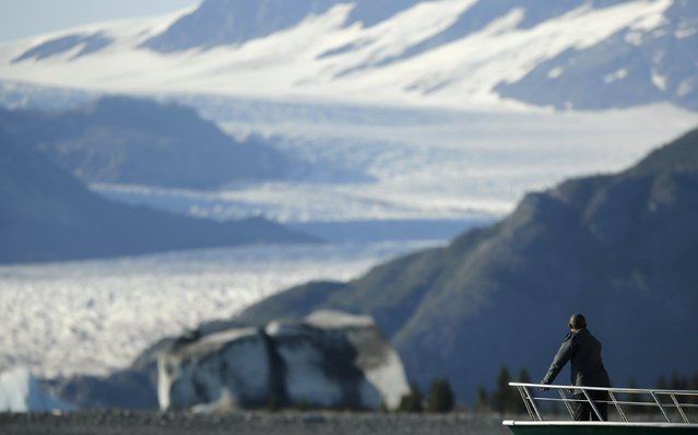 U.S. President Barack Obama views Bear Glacier on a boat tour of Kenai Fjords National Park in Seward, Alaska September 1, 2015. Obama on Tuesday proposed a faster timetable for buying a new heavy icebreaker for the U.S. Arctic, where quickly melting sea ice has spurred more maritime traffic and the United States has fallen far behind Russian resources. (Photo by Jonathan Ernst/Reuters)