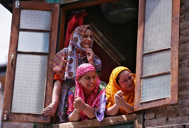Kashmiri women react as they watch the body of Riyaz Ahmad Shah, a civilian, who according to local media was killed on Tuesday night by pellets fired by Indian police, being carried away for his funeral in Srinagar August 3, 2016. (Photo by Danish Ismail/Reuters)