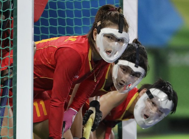 Chinese hockey players wear their protective face masks as they wait for a corner shot from the Netherlands during a women's field hockey match at the 2016 Summer Olympics in Rio de Janeiro, Brazil, Wednesday, August 10, 2016. (Photo by Hussein Malla/AP Photo)