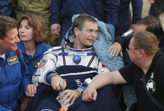 Denmark's astronaut Andreas Mogensen rests after landing near the town of Dzhezkazgan (Zhezkazgan), Kazakhstan, September 12, 2015. (Photo by Yuri Kochetkov/Reuters)