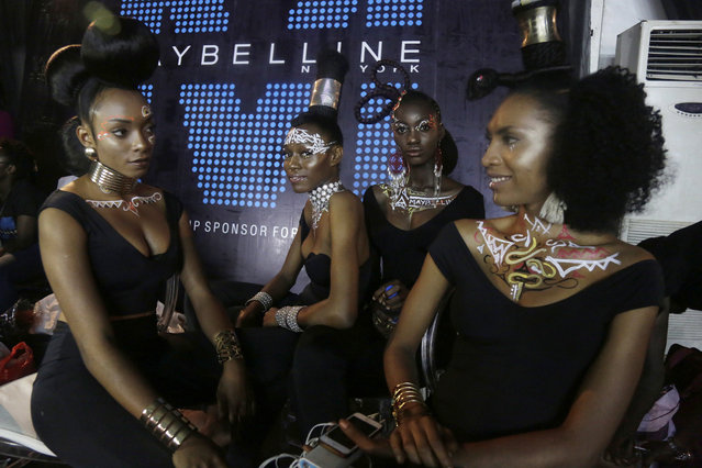 Models pose for photographs backstage as they display creations by Maybelline during the Fashion and Design Week in Lagos, Nigeria, Friday, October 27, 2017. (Photo by Sunday Alamba/AP Photo)
