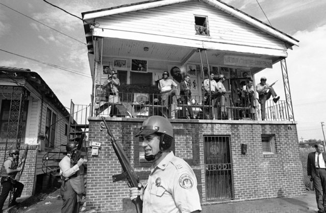 Police occupy the Black Panther headquarters in New Orleans following a shootout on Tuesday, September 16, 1970. Seven persons were wounded and 14 others were arrested during the incident. (Photo by AP Photo)