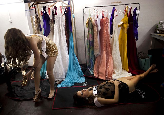 Contestants relax backstage during the Miss Argentina contest in Buenos Aires, November 7, 2012. (Photo by Natacha Pisaren/Associated Press)