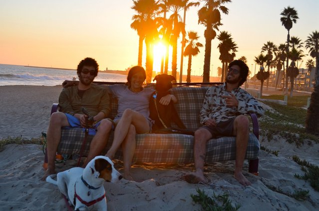Pictured sitting among various stunning locations, the friends used the futon as way to remember their 18,000-mile journey. Here they are seen n Big Sur, Calif. (Photo by Caters News)