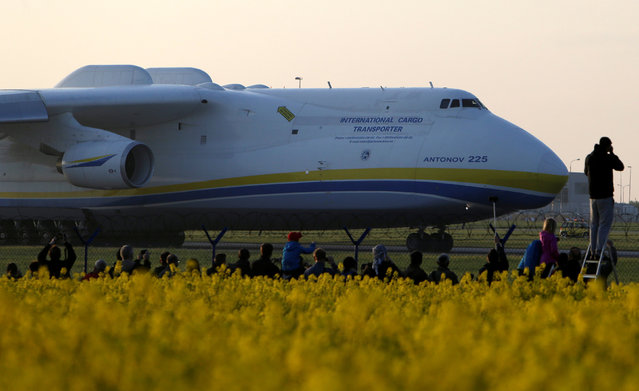 Plane spotters watch Antonov An-225 Mriya, a cargo plane which is the world's biggest aircraft, driving along the Vaclav Havel Airport for its first commercial flight from Prague to Perth, in Prague, Czech Republic, May 12, 2016. (Photo by David W. Cerny/Reuters)