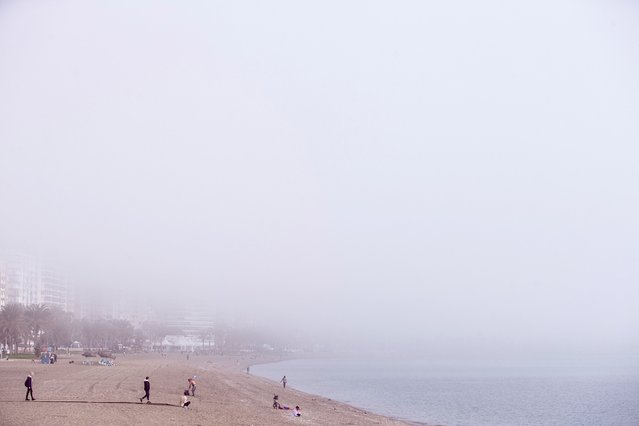 "A dense fog covers the sea at La Malagueta beach, in Malaga, Spain, 04 February 2020. This weather phenomenon is known by Malaga's fishers as ""Taro"", a Phoenician word originally that describes a dense fog covering Malaga's beaches caused by hot air from northern Africa makes contact with cooler Alboran Sea waters. (Photo by Jorge Zapata/EPA/EFE)"