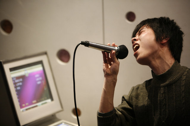 A man sings in a local karaoke club during a night out in Shanghai. (Photo by Nir Elias/Reuters)