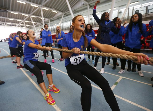 Miss Norway Monica Olivia Pedersen pulls on the rope during the tug of war event during the Miss World sports competition at the Lee Valley sports complex in north London, November 26, 2014. (Photo by Andrew Winning/Reuters)