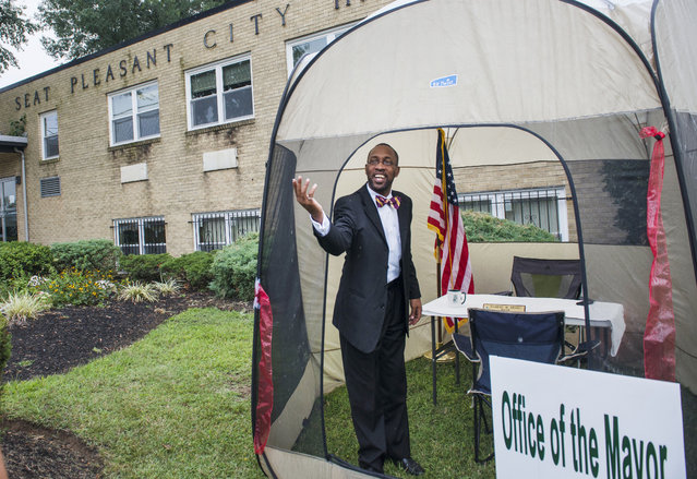 Seat Pleasant mayor, Eugene Grant welcomes supporters into a tent he has set up as his mobile office on the front lawn of Seat Pleasant City Hall on Friday, August  22, 2014 in Seat Pleasant, MD. Grant was ordered vacate his office due to how he allegedly treated some employees. (Photo by Amanda Voisard/For the Washington Post)