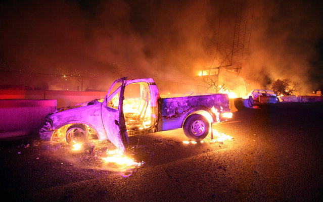 Burned cars are pictured in a highway in Ecatepec near Mexico city, on May 7, 2013. A gas tanker exploded in a Mexico City suburb on Tuesday, killing at least 18 people and damaging several homes and cars, an official said. (Photo by Victor Rojas/AFP Photo)