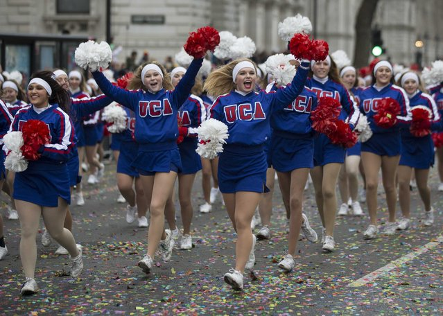 Members of the U.S. Universal Cheerleaders Association wave their pom-poms at the finish of the annual New Year's Day Parade in London January 1, 2015. (Photo by Peter Nicholls/Reuters)