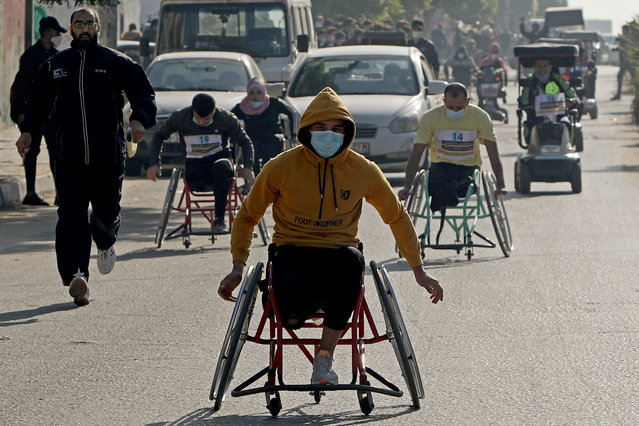 Disabled Palestinians compete during a local race, on International Day of Persons with Disabilities, in Gaza City on December 3, 2020. (Photo by Mohammed Salem/Reuters)