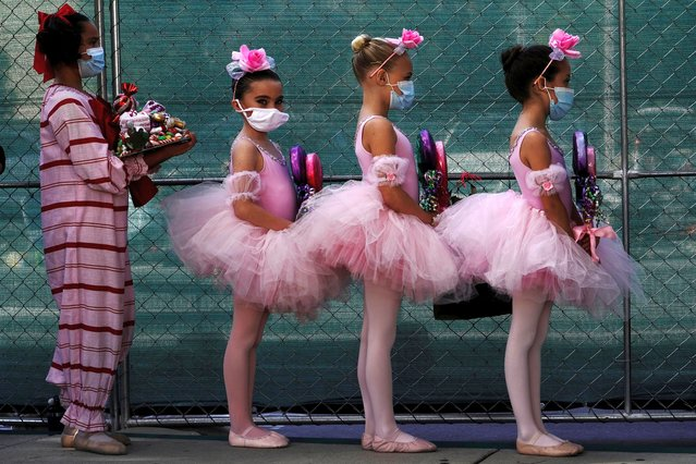 "San Diego Ballet School students wear protective masks backstage during a performance of ""The Nutcracker"", presented by the San Diego Ballet in a drive-in performance at a parking lot in San Diego, California, December 5, 2020. (Photo by Bing Guan/Reuters)"