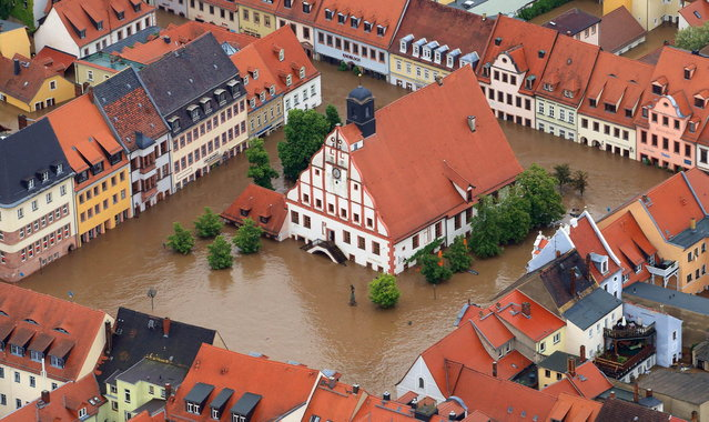 The city hall of Grimma, eastern Germany, is surrounded by floods Monday, June 3, 2013. Flooding has spread across a large area of central Europe following heavy rainfall in recent days. (Photo by Jens Wolf/AP Photo/Dpa)