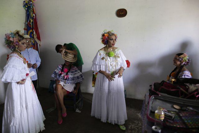 "Women wearing traditional clothing known as ""Pollera"" get ready to take part in the annual Thousand Polleras parade in Las Tablas, in the province of Los Santos January 10, 2015. (Photo by Carlos Jasso/Reuters)"