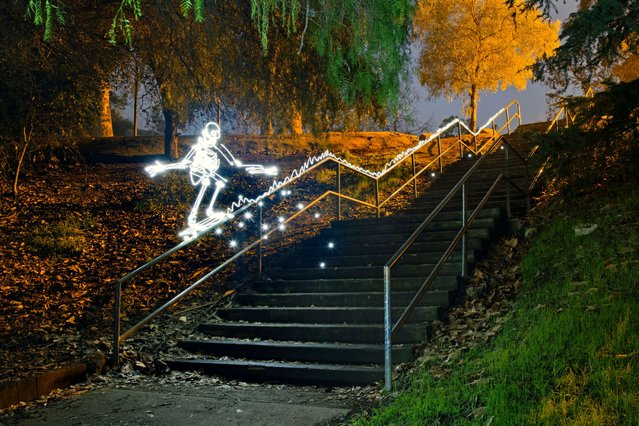 A light skateboarder grinding a rail. (Photo by Darren Pearson/Caters News)