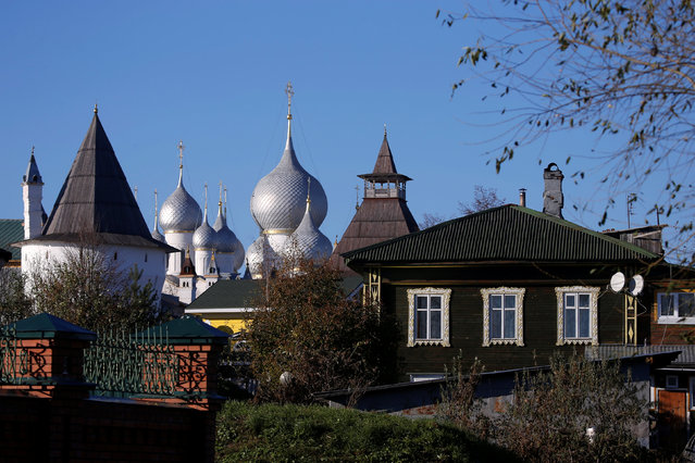 A general view of the wooden house and the domes of Rostov Kremlin in Rostov in Yaroslavl region in Russia, October 24, 2016. (Photo by Maxim Shemetov/Reuters)