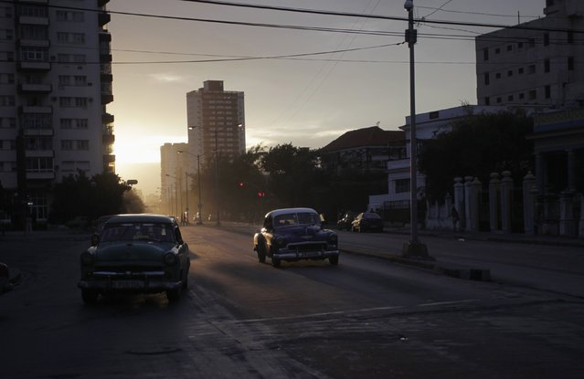Vintage cars drive during late afternoon in Havana January 20, 2015. Cuba will tell the United States in face-to-face talks this week it wants to be removed from the U.S. list of state sponsors of terrorism before restoring diplomatic relations, a senior foreign ministry official said on Tuesday. The two adversaries will meet in Havana on Wednesday and Thursday in an attempt to restore ties that the United States severed in 1961. (Photo by Reuters/Stringer)