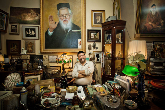 """The Art Dealer"". An art dealer at his office desk, shot in Jaffa's flea market, Israel. (Photo and caption by Lior Patel/National Geographic Traveler Photo Contest)"