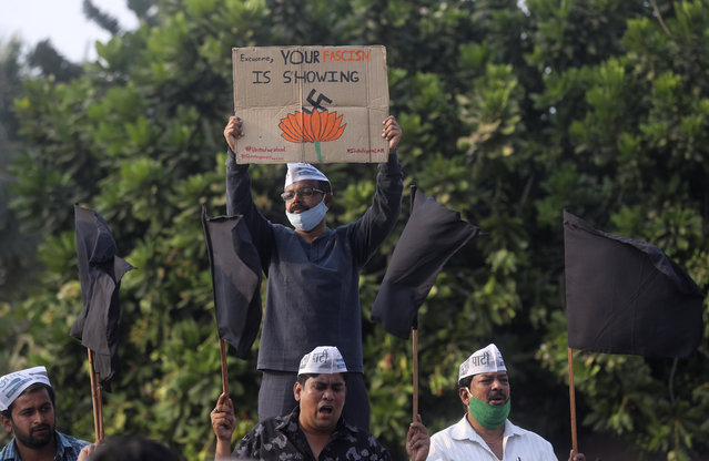 Members of Aam Aadmi Party shout slogans demanding the release of Indian climate activist Disha Ravi, during a protest in Mumbai, India, Monday, February 15, 2021. The 22 years old activist was arrested Saturday for circulating a document on social media that allegedly incited protesting farmers to turn violent last month. (Photo by Rafiq Maqbool/AP Photo)