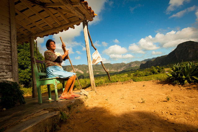 """Devotion to the Land"". Dora and her husband are farmers living in the ancient valley of Vinales in northwest Cuba. This valley is studded with ancient limestone pillars called mogotes that stand like guardians over the fertile fields of tobacco and corn. (Photo and caption by James Kao/National Geographic Traveler Photo Contest)"