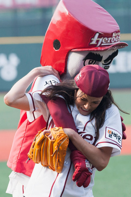Michelle Rodriguez and Nexen Heroes mascot wrestle during the KBO Championship match between Nexen Heroes and SK Wyverns at Mokdong Baseball Stadium on May 12, 2013 in Seoul, South Korea. (Photo by Han Myung-Gu/WireImage)