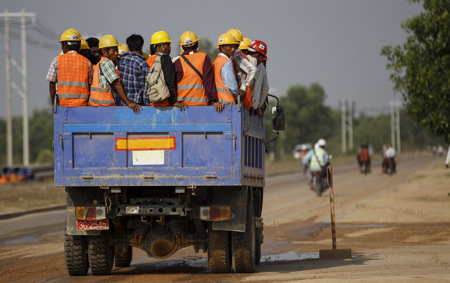 Workers are transported via truck to the site of the Thilawa Special Economic Zone (SEZ) project at Thilawa May 8, 2015. (Photo by Soe Zeya Tun/Reuters)