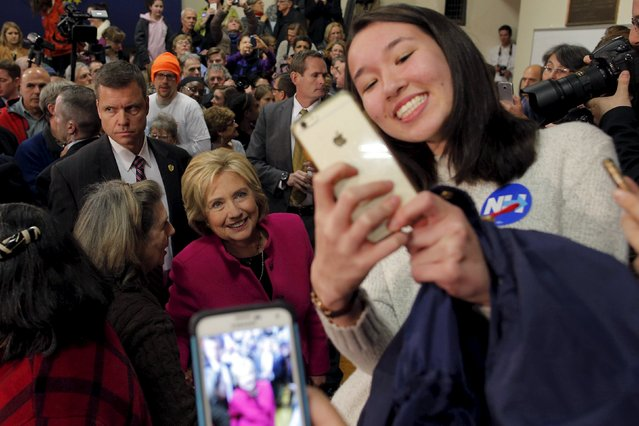 U.S. Democratic presidential candidate Hillary Clinton poses for a selfie with audience members at a campaign town hall meeting in Salem, New Hampshire December 8, 2015. (Photo by Brian Snyder/Reuters)