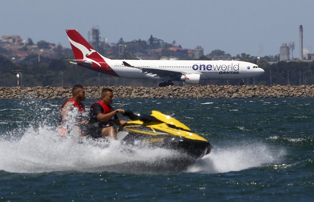 A Qantas Airways Airbus A330-200 jet prepares to take off from Sydney International Airport as jetskiers pass by on Botany Bay, December 18, 2015. Australian tax authorities on Thursday took the unprecedented step of publishing the records of hundreds of companies, including Qantas which show they paid little or no tax on their in-country earnings. (Photo by Jason Reed/Reuters)
