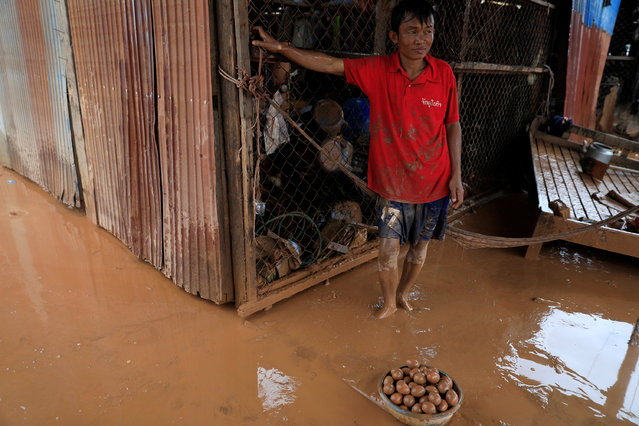 A resident looks on next to the eggs collected from mud during the flood after the Xepian-Xe Nam Noy hydropower dam collapsed in Attapeu province, Laos on July 26, 2018. (Photo by Soe Zeya Tun/Reuters)