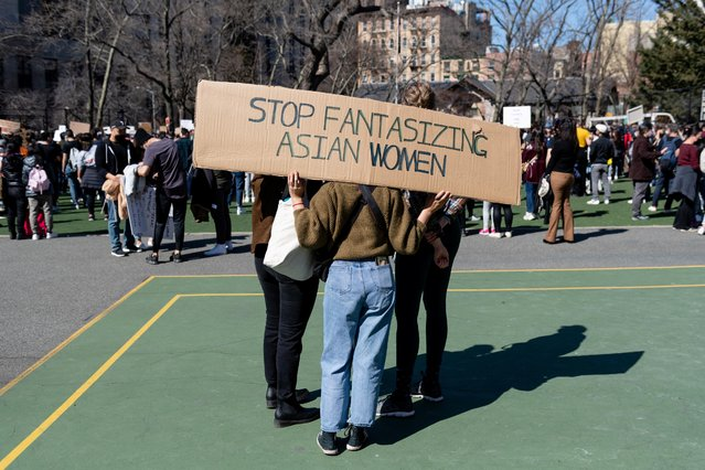 A person rests a sign on their shoulders during a Rally Against Hate to end discrimination against Asian Americans and Pacific Islanders in New York City, U.S., March 21, 2021. (Photo by Eric Lee/Reuters)