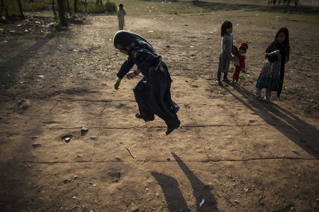 A girl jumps as she plays hopscotch on the outskirts of Islamabad February 11, 2015. (Photo by Zohra Bensemra/Reuters)