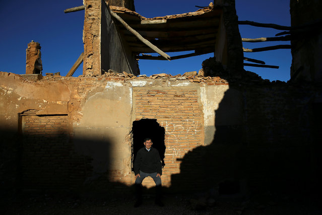 Tomas Ortin, 94, survivor of the Belchite battle, poses for a picture at the ruins of his former home in the old village of Belchite, in northern Spain, November 14, 2016. (Photo by Andrea Comas/Reuters)