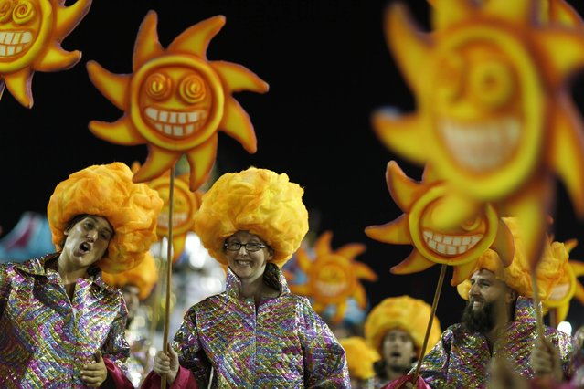 Revellers from the Alegria da Zona Sul samba school take part in the Group A category of the annual Carnival parade in Rio de Janeiro's Sambadrome, February 14, 2015. (Photo by Pilar Olivares/Reuters)