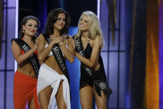 Miss Minnesota Rebecca Yeh, center, is congratulated by Miss Kentucky Jenna Day, left, and Miss Mississippi Chelsea Rick after Yeh advanced beyond the lifestyle competition during the Miss America 2014 pageant, Sunday, September 15, 2013, in Atlantic City, N.J. (Photo by Mel Evans/AP Photo)