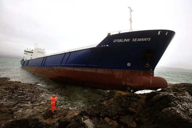 The container ship Lysblink Seaways, sits on rocks after it ran aground at Kilchoan, in the West Highlands of Scotland, Wednesday February 18, 2015. No one was reported injured when the ship ran in the early hours Wednesday. (Photo by Andrew Milligan/AP Photo/PA Wire)