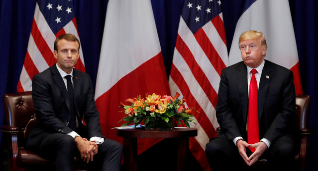 France's President Emmanuel Macron and U.S. President Donald Trump react as they hold a bilateral meeting on the sidelines of the 73rd United Nations General Assembly in New York, U.S., September 24, 2018. (Photo by Carlos Barria/Reuters)