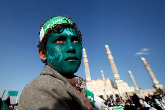A supporter of the Houthi movement attends a rally marking the birth anniversary of Prophet Mohammed, in Sanaa, Yemen December 11, 2016. (Photo by Khaled Abdullah/Reuters)