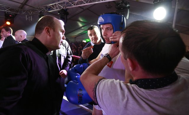 Fr Pierre Pepper (2nd R) receives instructions before defeating Jared Madden during his amateur boxing match in the town of Banagher in County Offaly March 15, 2015. (Photo by Cathal McNaughton/Reuters)