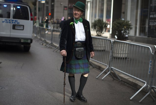 Noel Ryan of New York City wears traditional Irish clothing as he stands on 5th Avenue before marching in the 254th New York City St. Patrick's Day parade in the Manhattan Borough of New York, March 17, 2015. (Photo by Mike Segar/Reuters)