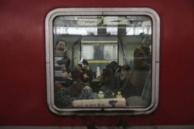 Passengers are seen inside a train travelling from Shanghai to Shijiazhuang at the station in Wuxi, China, January 27, 2016, after migration for the annual Chinese Lunar New Year and Spring Festival began. (Photo by Aly Song/Reuters)