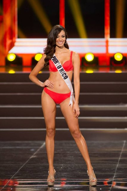 This photo provided by the Miss Universe Organization shows Monic Perez, Miss Puerto Rico 2013, competes in the swimsuit competition during the Preliminary Competition at Crocus City Hall, Moscow, on November 5, 2013. (Photo by Darren Decker/AFP Photo)