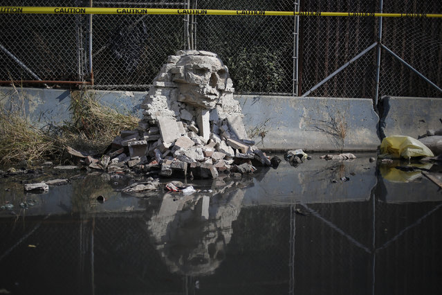 A rock formation by British graffiti artist Banksy is seen in the Queens borough of New York October 22, 2013. (Photo by Shannon Stapleton/Reuters)