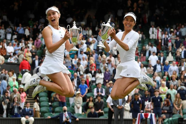 Taiwan's Hsieh Su-wei (R) and Belgium's Elise Mertens celebrate with the trophies after winning the women's doubles final against Russia's Elena Vesnina and Veronika Kudermetova on the twelfth day of the 2021 Wimbledon Championships at The All England Tennis Club in Wimbledon, southwest London, on July 10, 2021. (Photo by Toby Melville/Reuters)