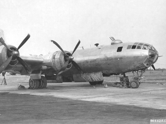 """Duchess"". Bell-Atlanta B-29-15-BA Superfortress, s/n 42-63411, 677th Bomb Squadron, 444th Bomb Group, 20th Air Force, Diamond #61 / Triangle N 61. Flown by Maj. Frank C. Stineman. Engine failure during take-off caused them to run off the end of the runway and the nosewheel collapsed, causing the damage shown. She was repaired and returned to service but was sent back to the U.S. as ""War-Weary"" on June 13, 1945. Dudhkundi, India. (Photo from D. Sheley collection)"