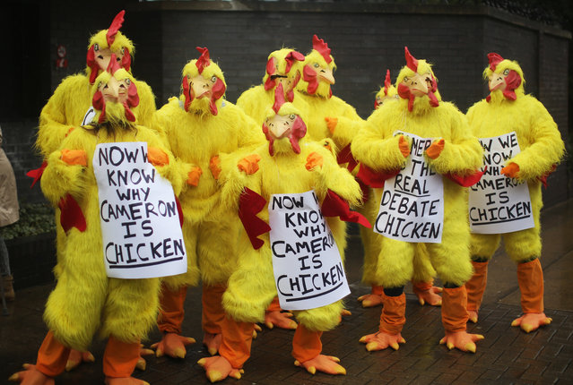 People dressed as chickens hold banners aimed at Prime Minister David Cameron ahead of David Cameron addressing delegates at the Conservative party's Spring Forum on March 28, 2015 in Manchester, England. Party supporters are being rallied as the tory party starts it's election campaign at the old Granada television studios. (Photo by Christopher Furlong/Getty Images)