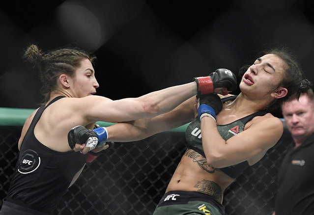 Montana De La Rosa, left, of the U.S., and Australia's Nadia Kassem fight during their Women's Flyweight bout at the UFC 234 event in Melbourne, Australia, Sunday, February 10, 2019. (Photo by Andy Brownbill/AP Photo)