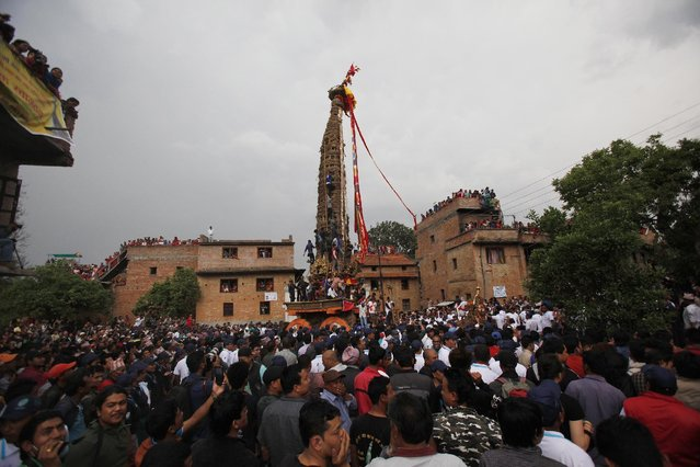 Nepalese devotees gather on the first day of Rato Machindranath chariot festival in Bungmati, Lalitpur, Nepal, Wednesday, April 22, 2015. (Photo by Niranjan Shrestha/AP Photo)