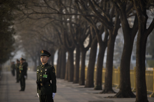 A Chinese paramilitary policeman stands guard outside of the Great Hall of the People before a meeting one day ahead of the opening session of China's National People's Congress (NPC) in Beijing, Monday, March 4, 2019. (Photo by Mark Schiefelbein/AP Photo)